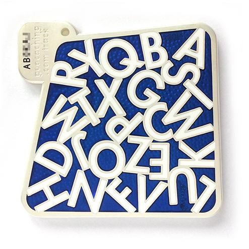alfabetoxic geocoin